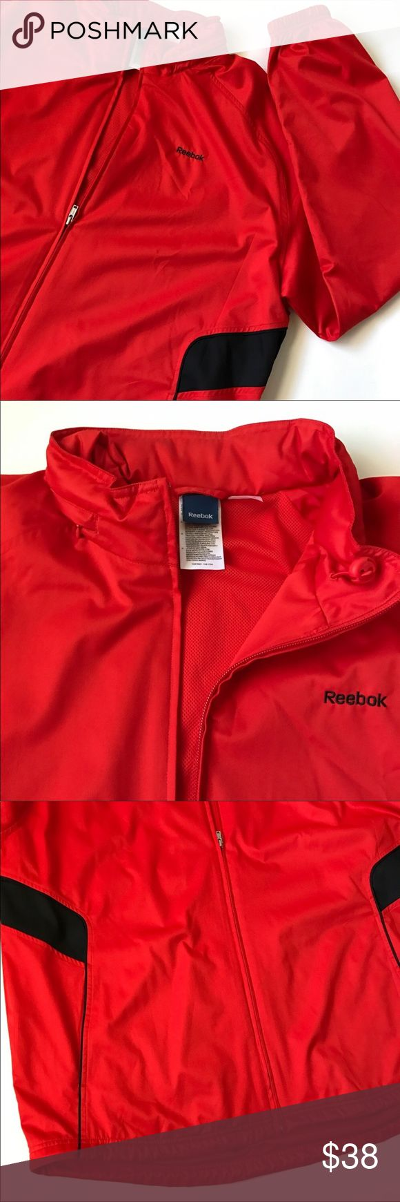 Men's reebok jacket Perfect for a warm, windy day. Perhaps a take along for your golf trip today. Blue panels above the pockets. Mesh lining. Hidden hood zipped inside the collar. Vintage style!  Color: Red orange Fabric: 100% Polyester  Size: 2XL Reebok Jackets & Coats Windbreakers