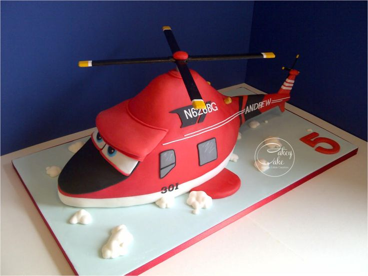 This was another first for CakeyCake and it was quite a challenge, but oh how we love a challenge! Sculpted from layered vanilla sponge around a custom built internal structure that supported both the top rotor blades and the tail, this enormous...