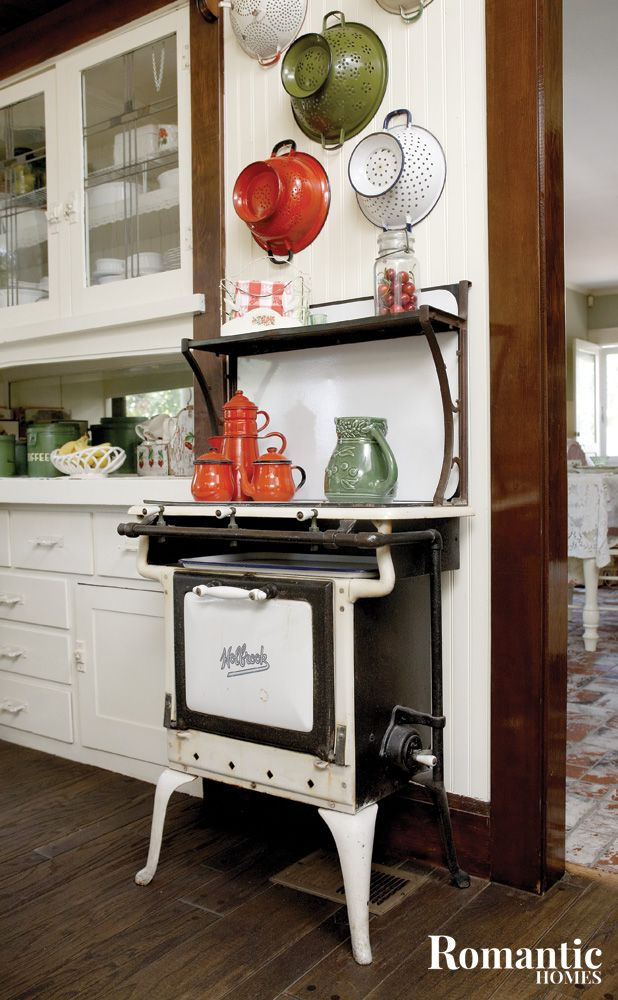vintage stove displayed with kitchen collectibles 729