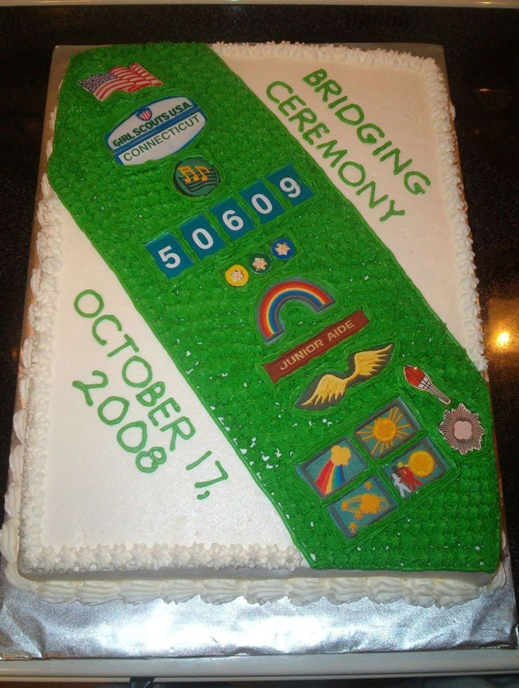 Girl Scout Sash Cake I made this cake for my daughter's Jr. Girl Scout Troop's bridging ceremony using the troop sash as a model...