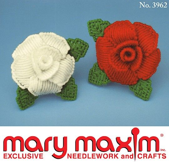 Create these Christmas roses using plastic canvas and yarn.