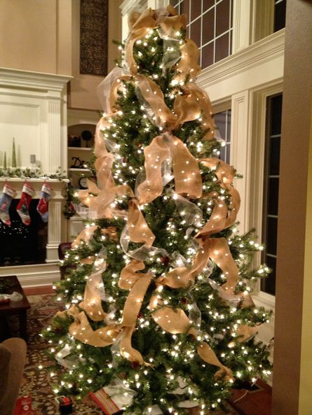 Tulle and burlap Christmas tree. Geez-- I hope we have a tree (and a house) that looks like that one day!