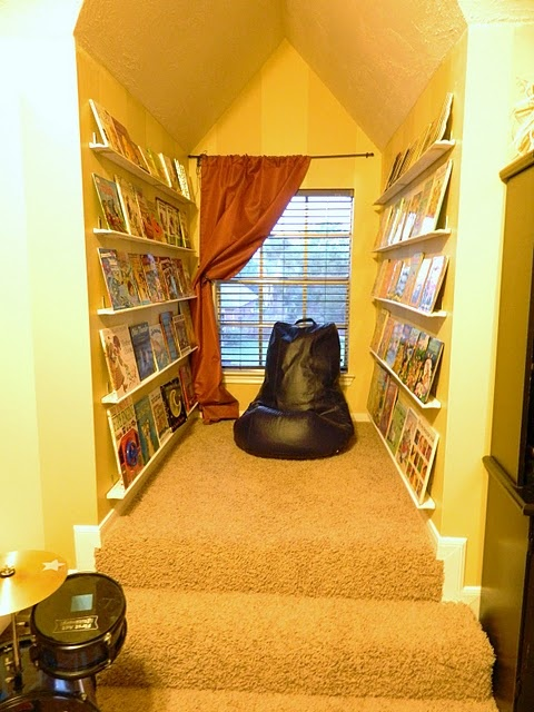 Love this little book nook. Love how the book shelves are the length of the whole wall using trim.