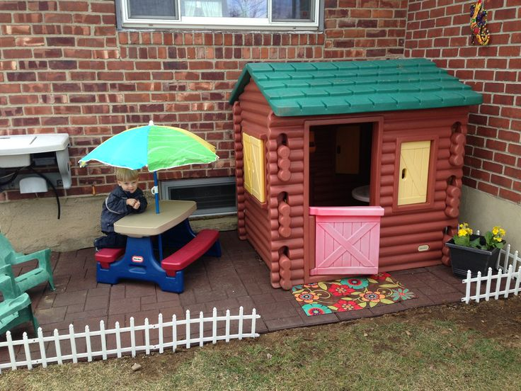 """Playhouse area: The stones are recycled rubber tires. Home Depot 18""""x18"""", plastic clips underneath that lock them together."""