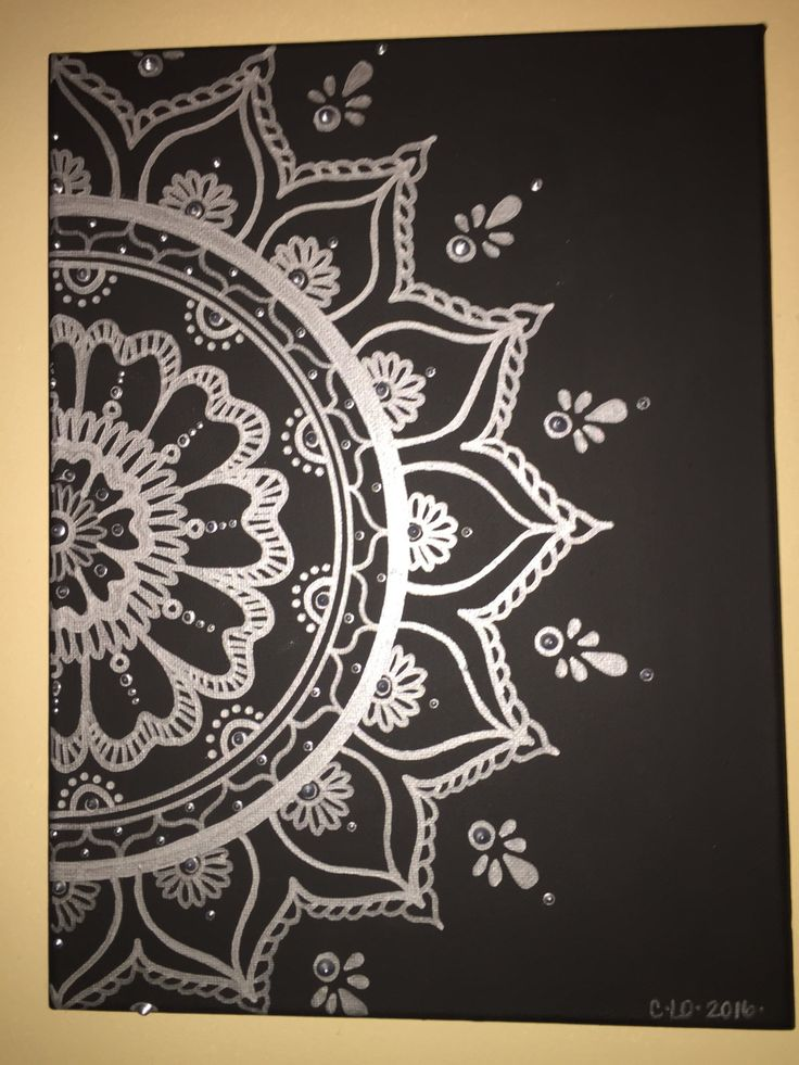 This Silver Mandala is done on a 9X12 canvas. Painted black with a silver metallic mandala with acrylic paint and paint marker. Fabric paint used to give the dots an embossed effect.  Ships with small free gift.