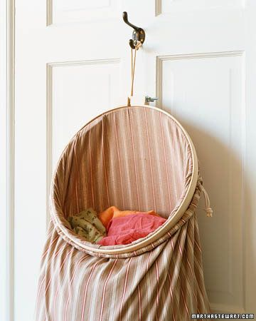 on the door laundry basket, saves floor space - pillowcase  wooden sewing hoop thing?  So easy!