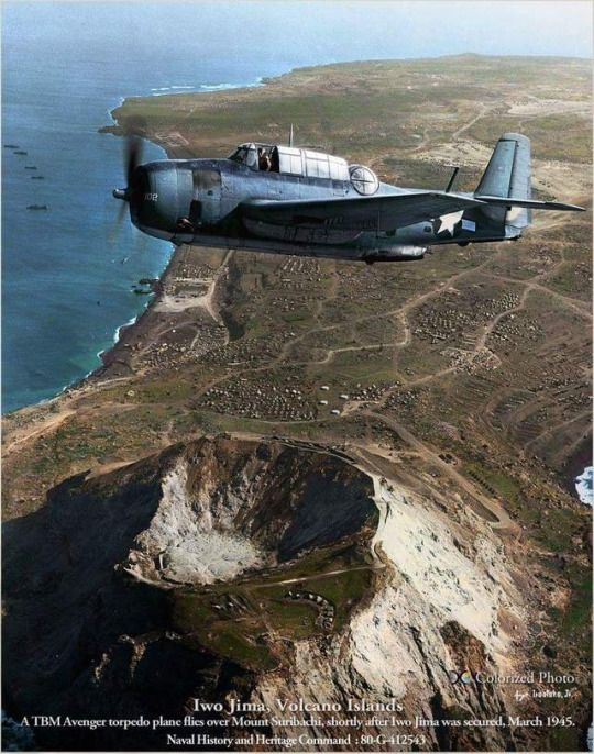 Grumman TBM Avenger torpedo bomber, flying from an offshore aircraft carrier, takes in an eagle eye view of Mount Suribachi on Iwo Jima, three weeks after D-day. March 1945.~ BFD