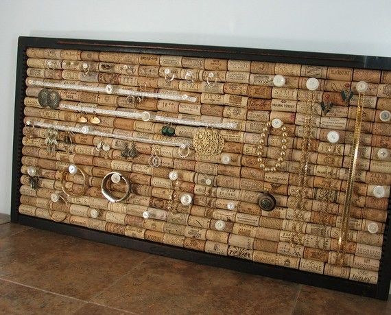 Stud and dangle earring holder made from wine corks.