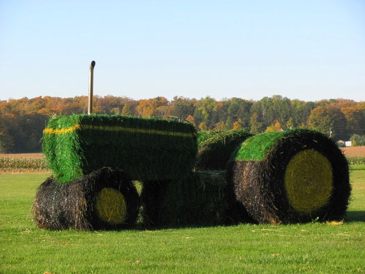 "Probably the coolest ""hay bale art"" that I have seen!  This is a great John Deere Tractor hay creation!"