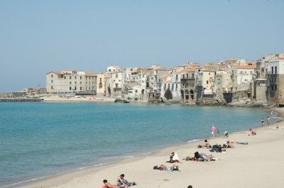 Cefalu's beach and turquoise sea in late May