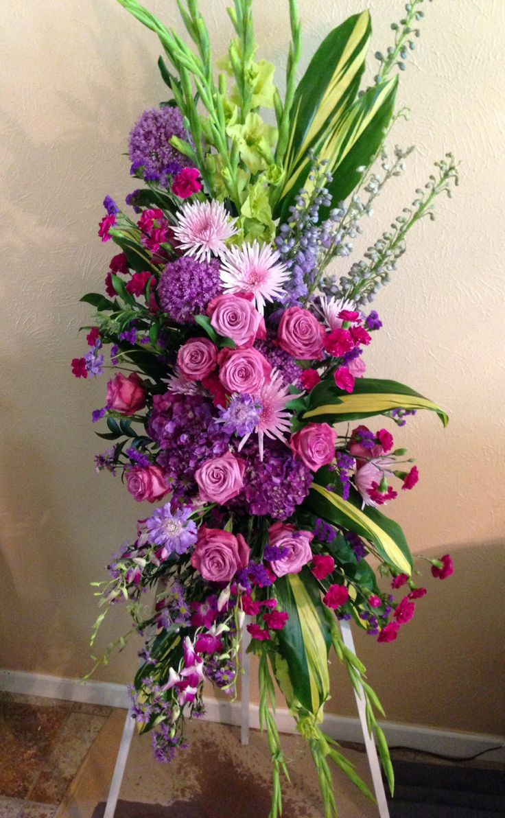 55 best funeral flowers and sympathy tributes by special occasions standing spray of mixed purple flowers izmirmasajfo