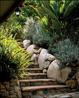Natural Home And Garden uses river rock here as the risers. I think I prefer a less smooth appearance - our granite here in San Diego has not been worn down by the aeons - at least where I live.