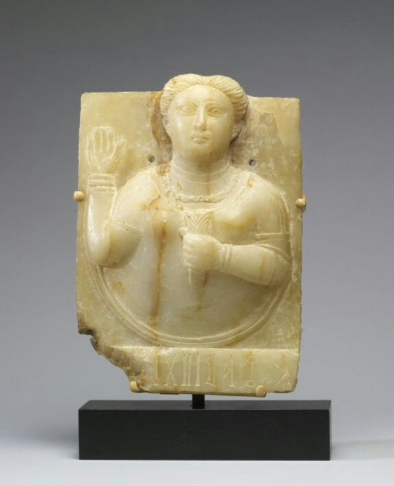 Calcite-alabaster stele with a female bust. South Arabian. 1st century B.C. - A.D. 1st century | The Walters Art Museum