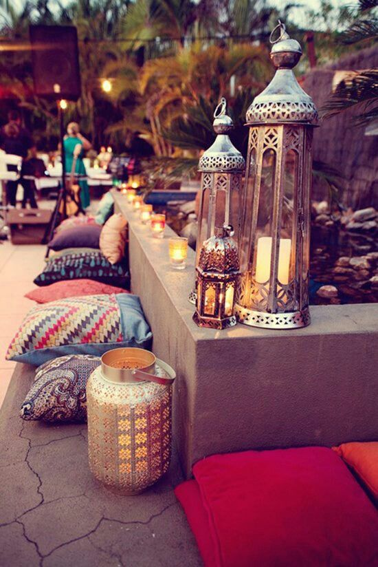 Gorgeous Lanterns, pillows. Cozy outdoor party, backyard.