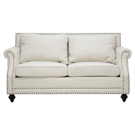 Pairing classic style with chic appeal, this linen-upholstered loveseat showcases rolled arms highlighted by nailhead trim.     Pr...