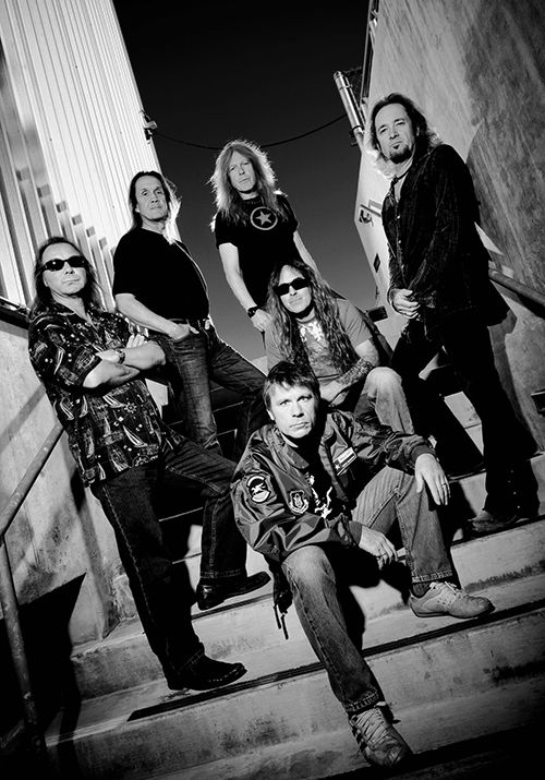 Iron Maiden current (2014) line up clockwise from left: Dave Murray (in shades), Nicko McBrain, Jannick Gers, Adrian Smith, Steve Harris, and Bruce Dickinson.