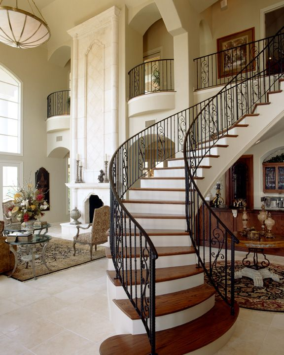 Graceful Curved Stairs, Wrought Iron Banister .... 2-story