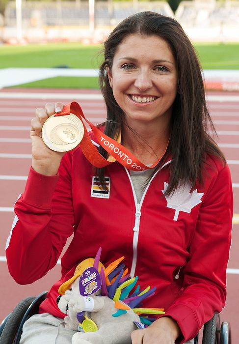 Toronto, ON - Aug 11 2015 - Michelle Stilwell receives her Gold Medal for Women's 100m T52 in the CIBC Athletics Stadium during the Toronto 2015 Parapan American Games  (Photo: Matthew Murnaghan/Canadian Paralympic Committee)