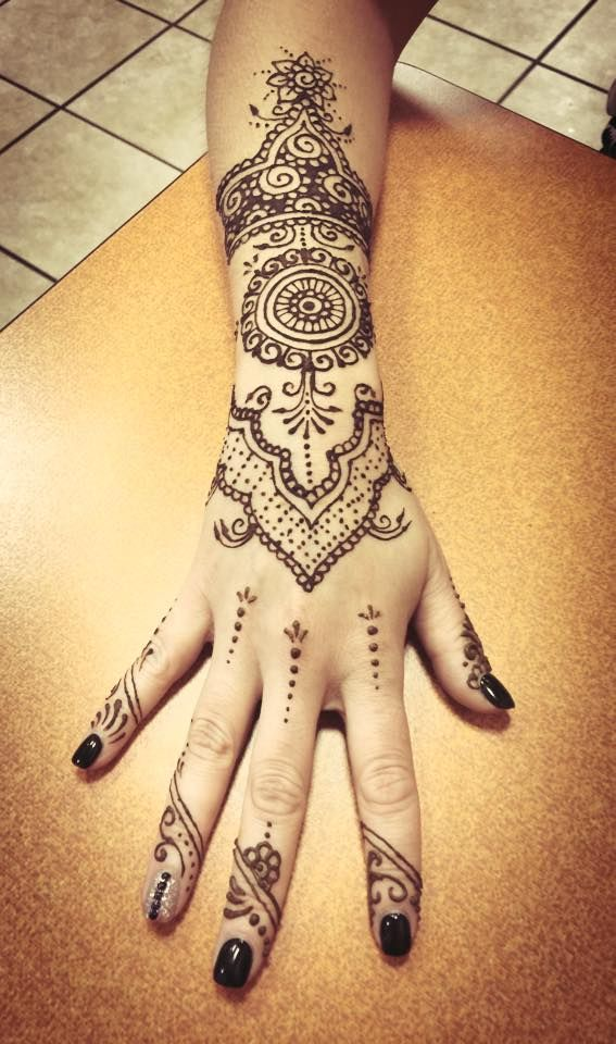 Ornate Henna Hand Tattoo by A.R.T. Graduate Oksana Weber. Click to learn more about getting a henna tattoo at one of our shops.
