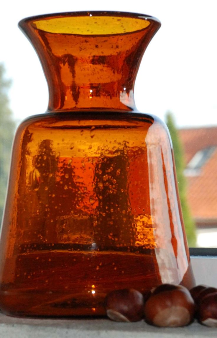 Old vase in thick Brown glass. Bubbles inside the glass. Love it! See more at www.evabyeva.dk