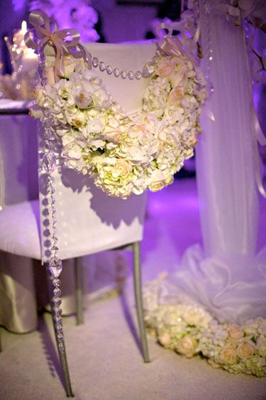 Bride and Groom Chairs for the sweetheart table In Cream and Lavender with Green Hydrangea  with crystal drapings    David Tutera Weddings