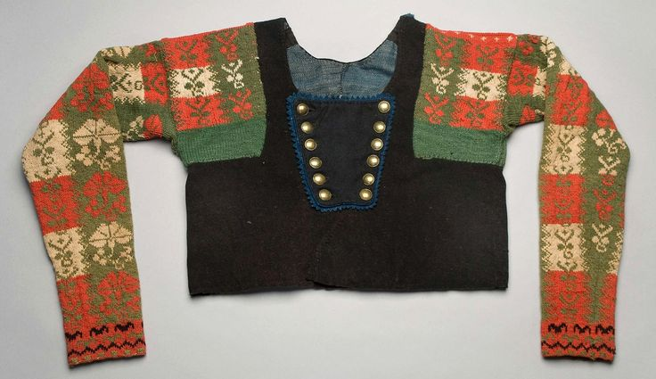 Woman's sweater from around1840 - 1869. Made of wool. Two front panels and four back panels. Possibly are some parts from an older garment stitched together with a different wool material.