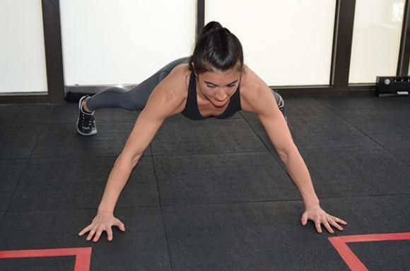 16-Minute Tone-Everything Workout: Walking Plank | Form Tip: Keep core muscles tight and hips in line with your shoulders throughout the exercise.
