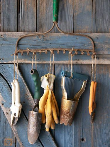 Hang an old rusty rake on the side of your garden shed to organize your gardening tools.   Get the tutorial at Natalme.