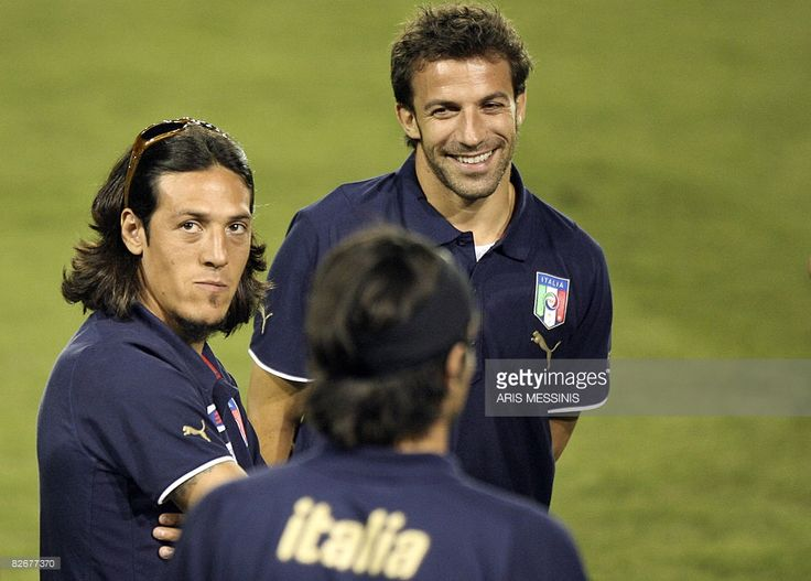 Italy's Mauro Camoranesi (L) looks on next to Alessandro Del Piero upon their…