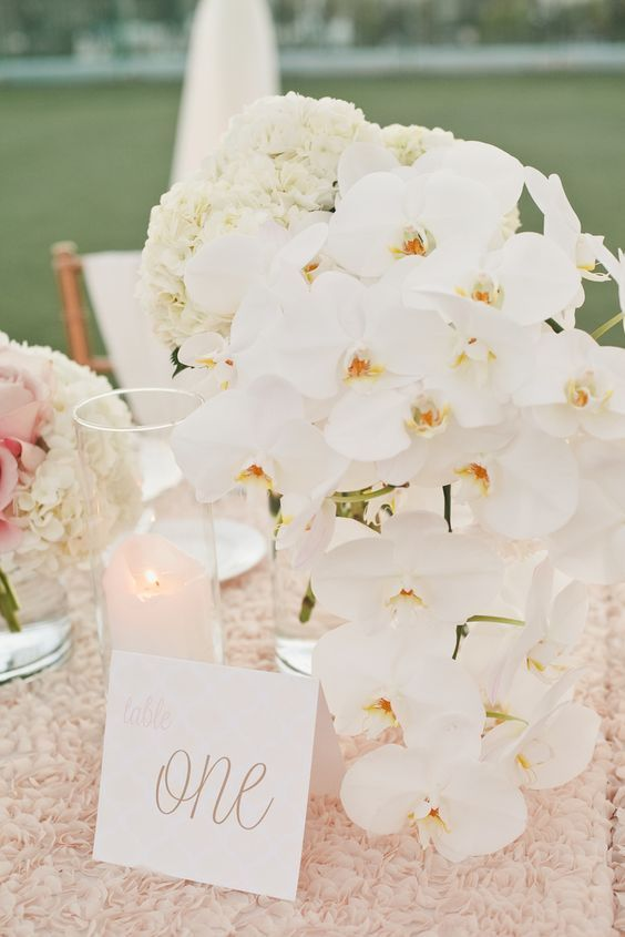 Stunning white orchid wedding reception centerpiece; Featured Photographer: Onelove Photography