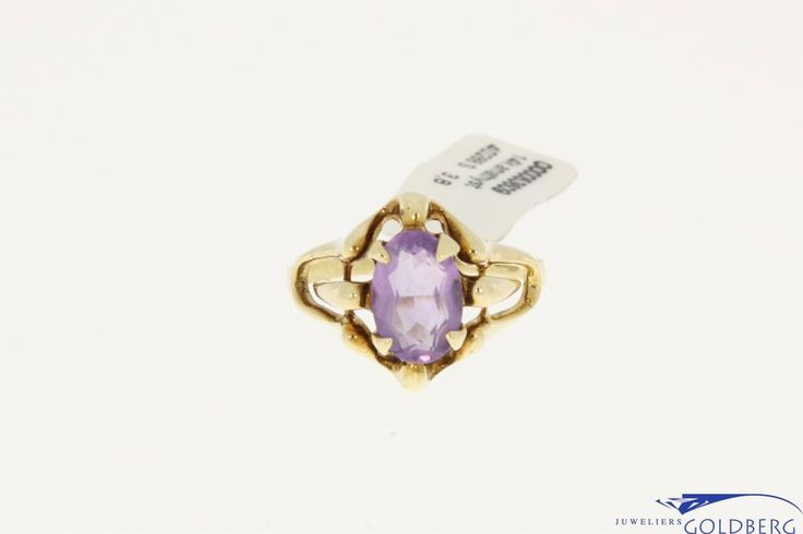 Very nice vintage 14k gold ring with amethyst. The ring has a beautiful and graceful open design with wave like lines. The amethyst is about 9mm long and 6mm wide.  For more information visit our site: http://www.goldbergjuweliers.nl/en/vintage-14k-gold-ring-with-amethyst.html