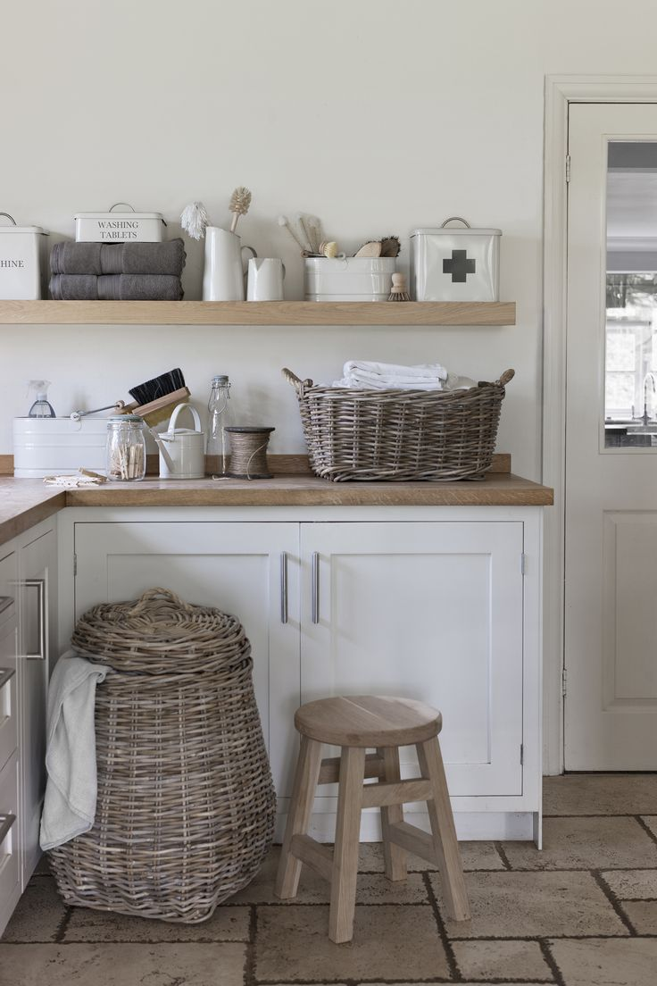 Laundry room - wicker, wood, natural bristle brushes we would never use, cream enamelware with beautiful fonts, jugs and tins. Love.