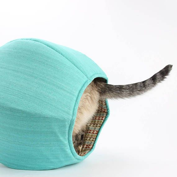 Our turquoise cotton cat bed is made with a coordinating lining in a Southwestern stripes fabric. This cat bed is made with Fall colors in mind, yet will look good with your cat (and your decor) all year long. The Cat Ball® is our original modern pet bed design. Our six panel pet bed offers a covered, private napping spot with with two openings, so you cat or small dog can exit or enter from either end. Our modern cat furniture design is made of fabric and foam, so it is entirely...