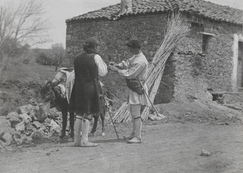 Two men and a donkey outside of a roadside inn. 1900s. Location: Peloponnesus Peninsula, Greece. Photographer: FRED BOISSONNAS/National Geographic Creative