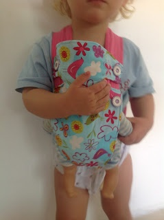 Baby Doll Carrier Tutorial.Emma's going to love this so she can wear her dolls when I wear Isabella