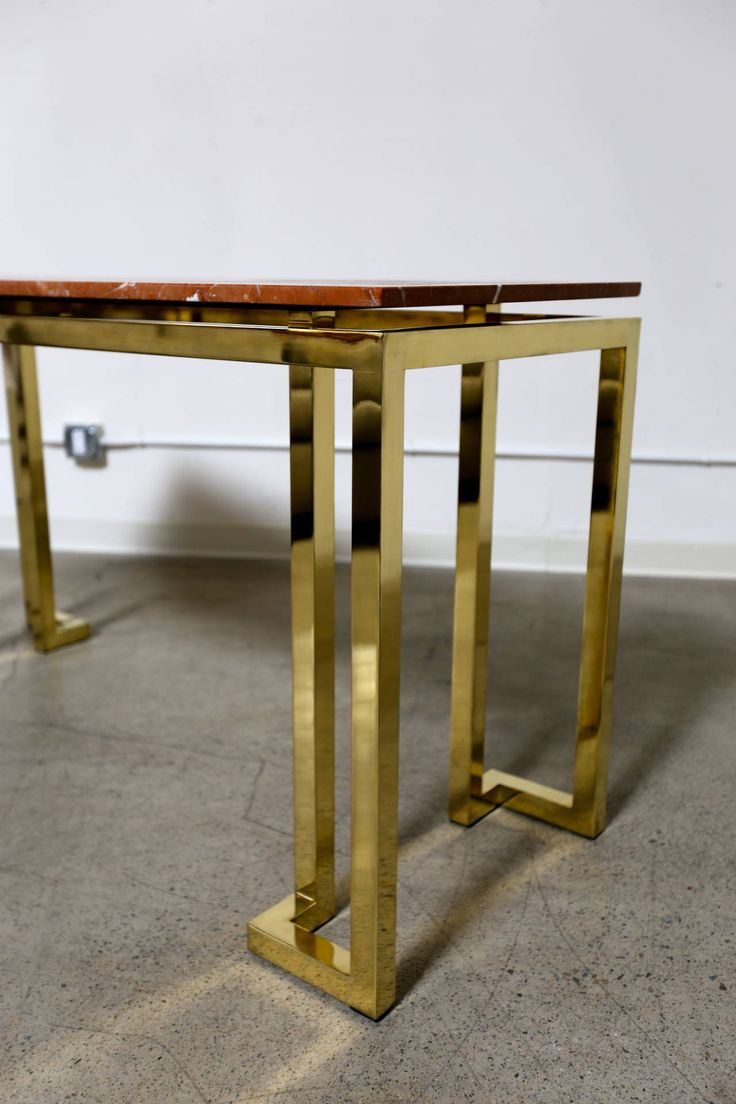 Large Polished Brass and Marble Console Table by Karl Springer | From a unique collection of antique and modern console tables at https://www.1stdibs.com/furniture/tables/console-tables/