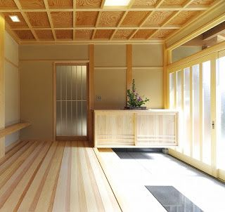 A Japanese Genkan - notice the lower entrance area and cupboard for storage of shoes.