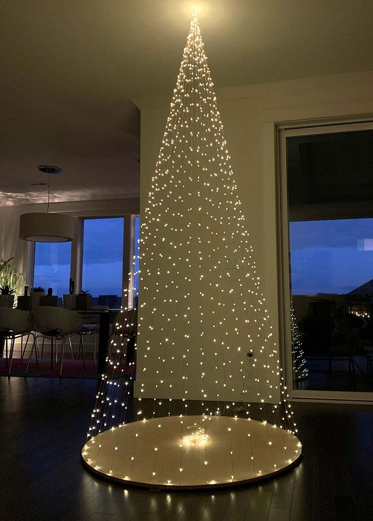 Diy Christmas Tree Made Using Only Firefly Lights Ohmeohmy Blog Hanging Christmas Lights Diy Christmas Tree Christmas Tree Decorations Diy