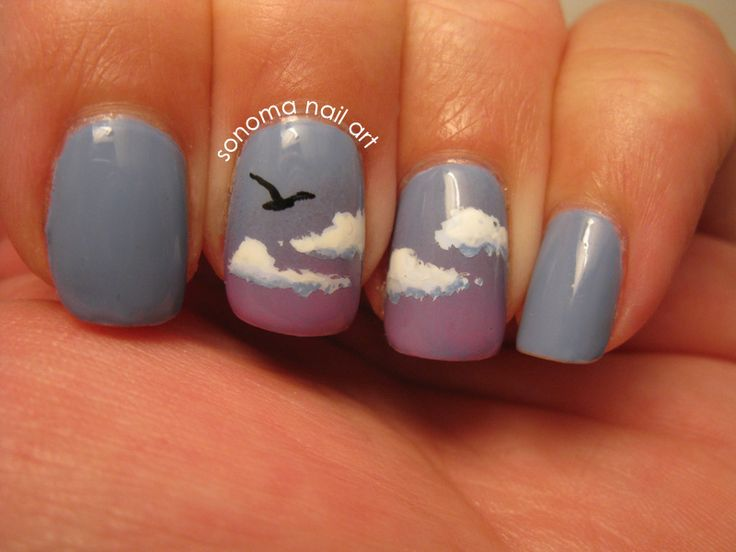 Dusk / twilight sky nails. The detailing in the clouds is beautiful. If only I could paint normally that well.