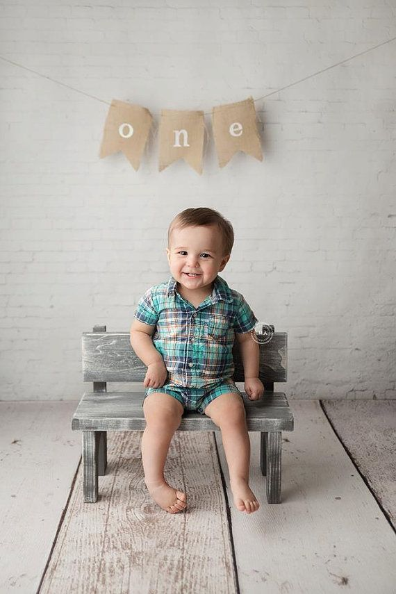I like this photo. I believe it is being lit by a natural light source such as a window from the right side of the subject. The light looks like it is being reflected onto right side of the baby's face. I would say this lighting is probably 2 to 1.