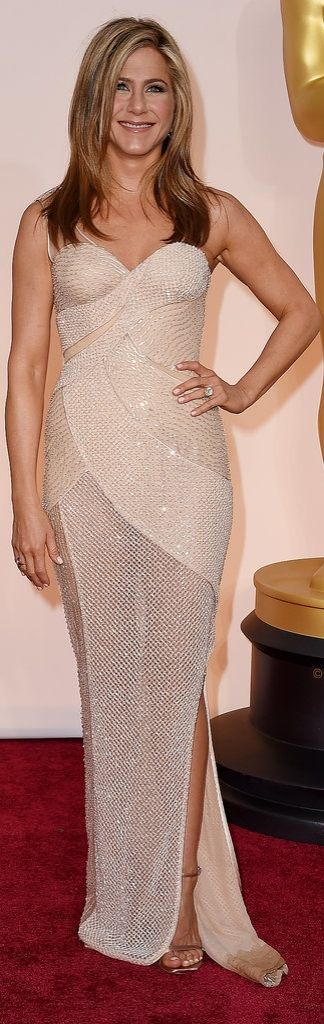 Jennifer Aniston in a semi-sheer Versace dress at the Oscars.