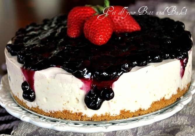 PRIZE WINNING CHEESECAKE - this cheesecake has a whipped can of evaporated milk, cream cheese, a prepared pkg of lemon jello, a little lemon juice, zest and sugar prepared and put in a springform pan with graham cracker crumb crust and topped with a blueberry filling.
