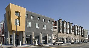 Oakland, CA! Low income homes. Outside is industrial and inside looks like town houses -- context.