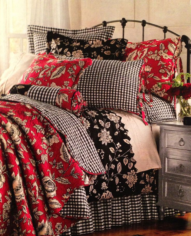 Would love this in the downstairs bedroom... white beadboard walls, paint headboard and dresser black, black floral, red floral and gingham check bedding.  LinenSource
