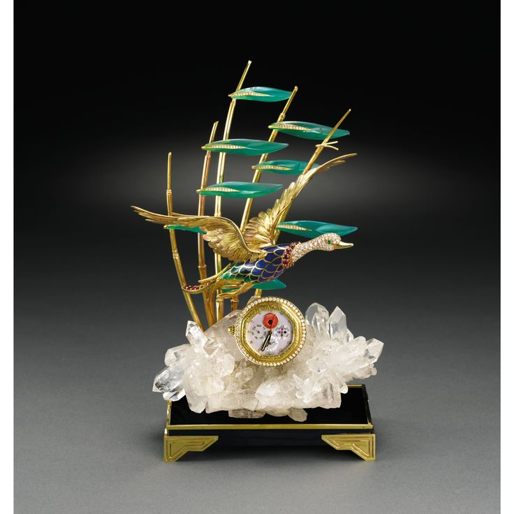 GÉRALD GENTA THE FLYING DUCK CLOCK A FINE AND RARE YELLOW GOLD, DIAMOND, RUBY, EMERALD, CORAL, MOTHER-OF-PEARL, ENAMEL, AGATE AND ROCK CRYSTAL MANTEL CLOCK WITH PERPETUAL CALENDAR, ALARM AND PHASES OF THE MOON CIRCA 1990
