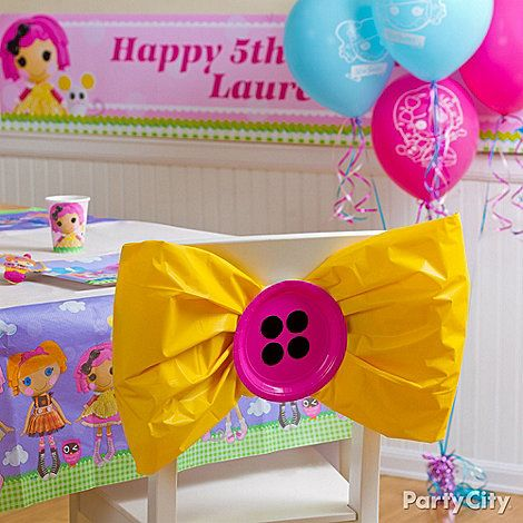 "Cute DIY alert! This sew-cute chair decoration is made of a plastic table cover and paper plates for ""buttons"". Get details from our Lalaloopsy party ideas guide!"