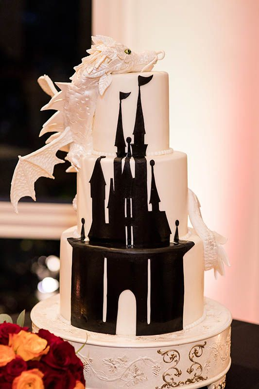 A dragon watches over a castle in this one-of-a-kind wedding cake.