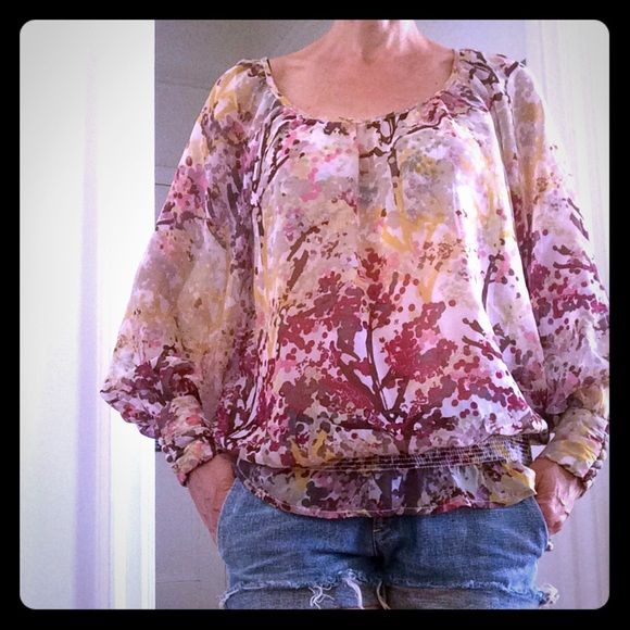 H&M Boho Sheer Chiffon Long Sleeve Top Nice painterly pattern. Sheer 100% polyester, but very wearable with neutral cami or bra underneath. Smocking at hem and nice button detail at sleeves. Long sleeves. Size 6. H&M Tops