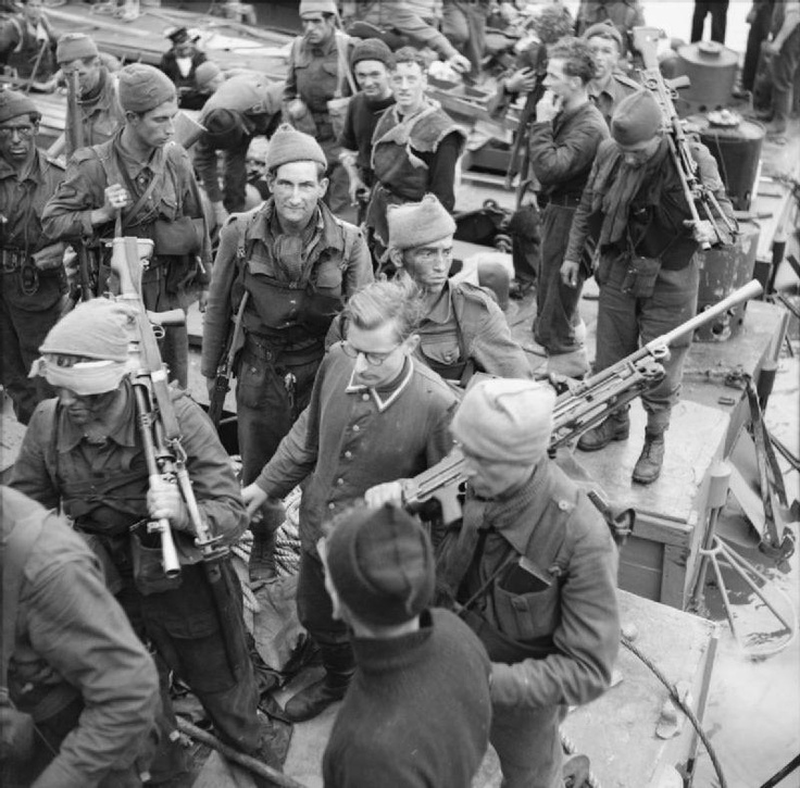 THE DIEPPE RAID, 19 AUGUST 1942. A German prisoner, Unteroffizier Leo Marsiniak, being escorted at Newhaven. He was captured at the gun battery at Varengeville by No. 4 Commando.