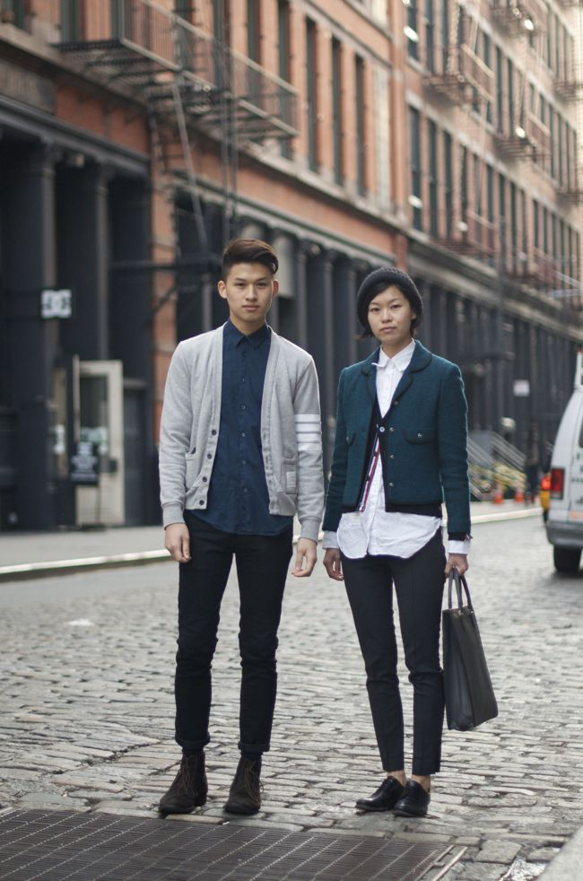 """""""David wears a classy Thom Browne cardigan and pants/boots by Acne. Julie wears a cute Thom Browne cardigan and shirt, shoes by Jil Sander  and a bag by Valextra."""""""